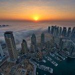 Sunrise in #Dubai. /Caters http://t.co/qiFn5Q2fyl