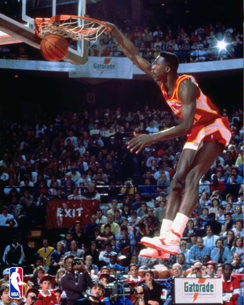 Happy birthday to the human highlight real Dominique Wilkins. I had this poster of him on my door as a kid