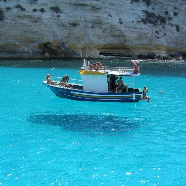 This picture is taken on One House Bay in Greece. The water is so clear that the boat seems to be floating on air. http://t.co/asoIOFCXFC