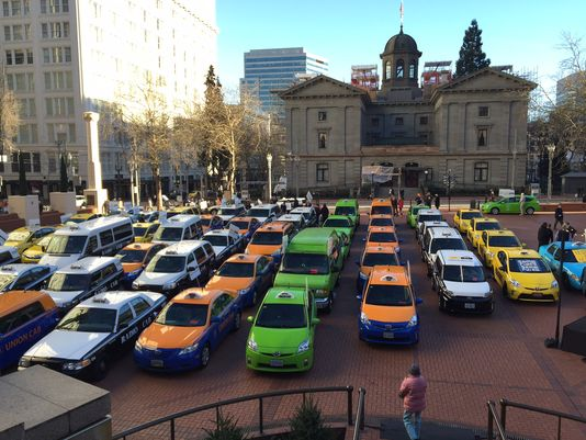At Pioneer Courthouse Square, cab drivers are protesting Uber in their own unique way. http://t.co/kp3UQOwoAp http://t.co/ON14uNbQy9