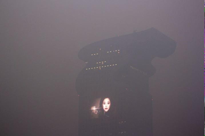 Not Blade Runner 2019. Pangu Building in smog, Beijing 2013. ht @samuel_wade http://t.co/Pol3RUJqZu
