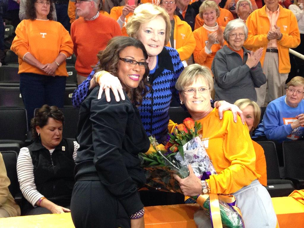 Before game, @NikkiCaldwell & @HollyWarlick presented @patsummitt with flowers. Touching #WeBackPat moment at TBA. http://t.co/9uwxmplQWz
