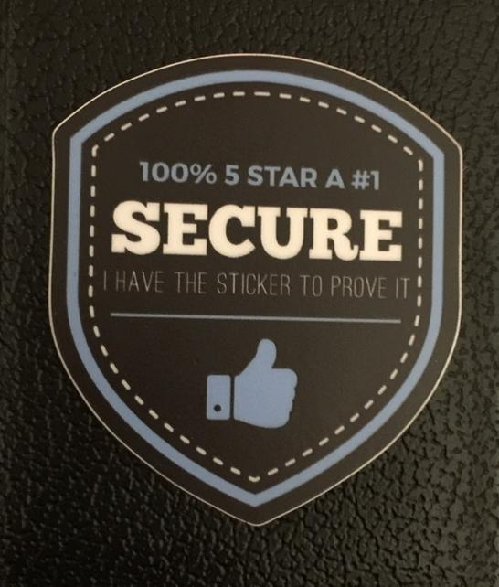 """The sad state of device security: """"It's secure because the sticker says so."""" #shmoocon #SecuritySarcasm http://t.co/cF42Zzm5HT"""