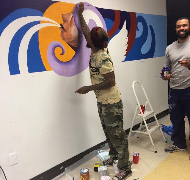 .@MiyaBailey painting a mural at the Atlanta Mission (Women and Children Shelter) in his @cityofsavages tie dye tee http://t.co/iEYWFy2Zmu