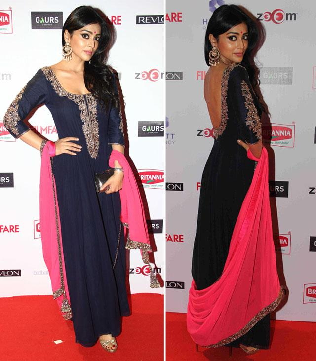 Actress Shriya Saran showed off her sexy back in a fab Manish Malhotra ensemble! Love the pop of pink!