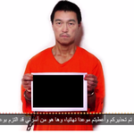 Breaking: New video released by ISIS shows Kenji Goto holding a still image of his beheaded Japanese cell mate. http://t.co/pmS55Lphgj