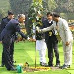 Barack Obama plants a sapling after paying tribute to Mahatma Gandhi at Rajghat.(Arvind Yadav/HT Photo) #ObamaInIndia http://t.co/vAl8GtWEKJ