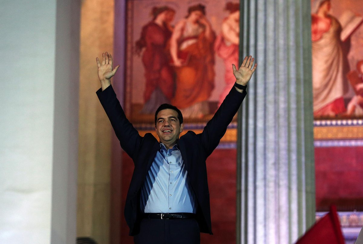 SYRIZA leader Alexis Tsipras waves to his supporters outside Athens University #Greece #ekloges2015 http://t.co/6fAQtrhgEW