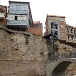 Houses perched at the edge of the Tsavkisistskali River gorge in Tbilisi. http://t.co/M2kuSF6ovS