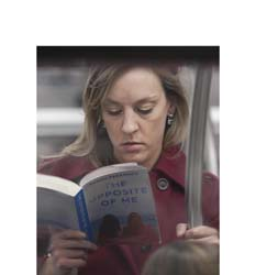 Seeking this NYC subway reader, currently featured in a photo exhibit. Point me to her, I'll send you a signed book! http://t.co/StxCnOWC1I