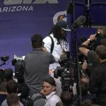 """UPDATE: Marshawn Lynch is done with his required 4.5 minutes: """"Time."""" — and Beast Mode is out! #SBMediaDay http://t.co/FXCAPgONIH"""