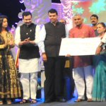 Honoured to present Suryoday Manavta Seva Puraskarto Dr Prakashji & DrMandatai Amte in presence of BhaiyyujiMaharaj http://t.co/RpXSi8b0oJ