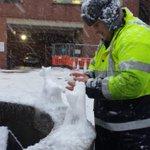 Heres Wayne braving the blizzard to make snow animals near the hospital main entrance #sheffieldsnow http://t.co/kt4GRzGgMr