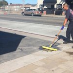 Firefighter cleans up blood, footprints from the scene where the man suspected of stabbing a Monterey woman jumped http://t.co/qTAGRXoAJ5