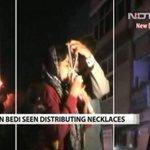 @ArvindKejriwal see this @thekiranbedi ji distributing Necklace..#AamAadmiKiSarkaar http://t.co/QCCKhLr2a7
