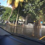 A pond in front of slave island police station creates traffic http://t.co/FOo9Qv2xhg