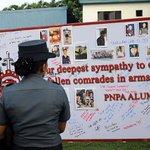 Members of PNP attend the necrological mass for the 44 slain SAF. Photo by Jansen Romero/Rappler #RStream http://t.co/JuMKJ0KpQ2