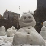 Snowmen invade #NYC and everybody is all smiles.