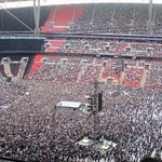 APC Rally at Wembley Stadium, UK.. Brooms and APC colors everywhere, #SaiBuhari chant can be heard as far as France http://t.co/2Z5PVHD4Fz