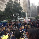 At the end of the march a few hundred have sat down in Central to listen to a sharing rally. #OccupyHK http://t.co/4EEtPT2ZQC