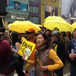 "Peaceful crowd carrying yellow umbrellas chants ""I want true democracy!"" as they march thru Hong Kongs Causeway Bay. http://t.co/3eCbmU3Uyz"