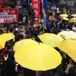 Sea of yellow umbrellas passing LongHair #HongKong #occupyHK http://t.co/JMuzL8vDYZ