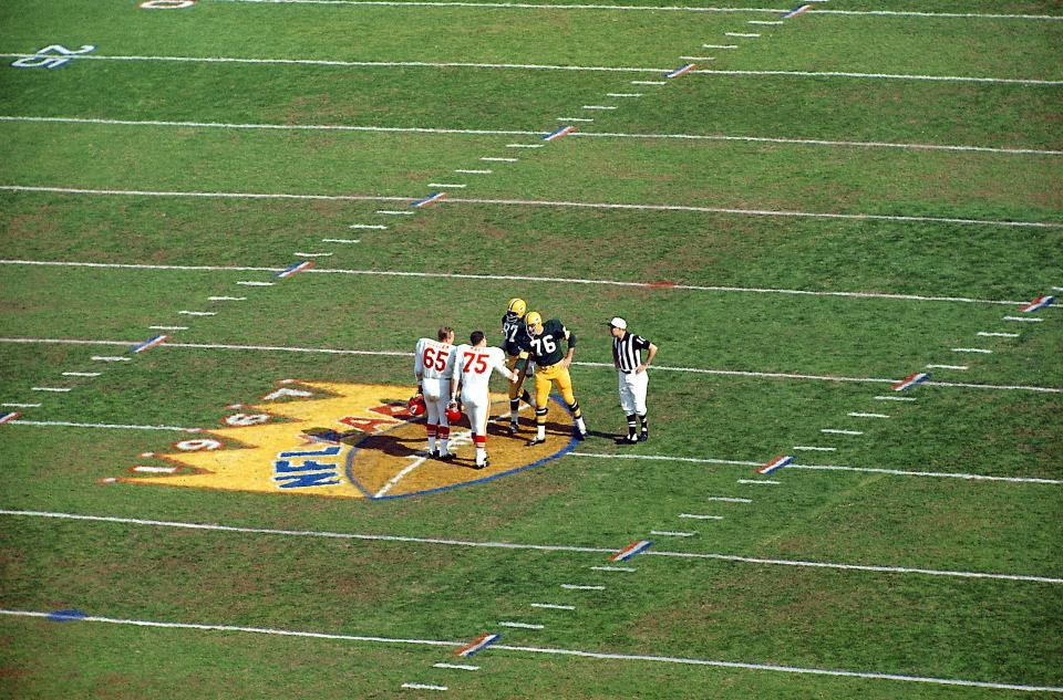 There are maybe 50 people on the field for the coin toss. At Super Bowl I, there were 5: http://t.co/92ri9Mc2RN