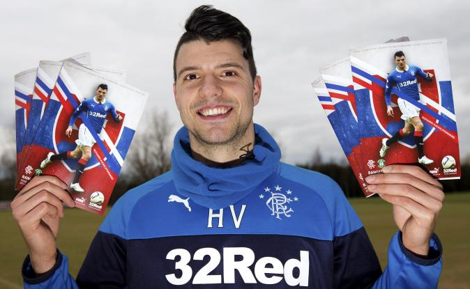 A photo of Rangers' SLOVENIAN loan signing, Haris Vuckic, posing with match programme, emblazoned with Slovakian flag