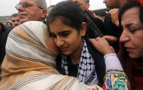 14-year-old #Palestinian Malak al-Khatib greeted after her release from #Israeli jail today. http://t.co/PHz0zGFheN http://t.co/hsg3xuKtF3