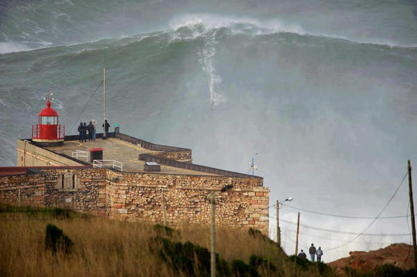 Greg Fitzsimmons (@GFitzsimmons): This is one of the most insane photos I've ever seen. @GMACHawaii absolutely #charging in Nazaré, Portugal! http://t.co/TDQy2Zvl