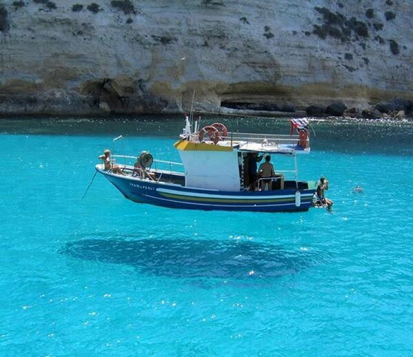 The water in One House Bay, Greece is so clear, boats seem to float on air. http://t.co/OWHe3TRSks