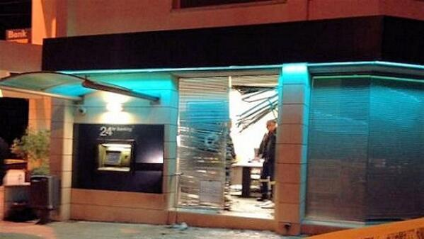 Theodora Oikonomides (@IrateGreek): Pic of reported explosion site RT @cypnew: Here is the bank #Cyprus http://t.co/sfDxdGDeFo #rbnews