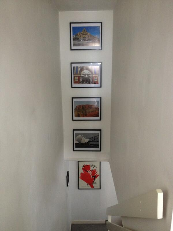 Holiday photos finally up on the stairs -with the help of a 15ft ladder! #vertigo http://t.co/FIwUen6Je0