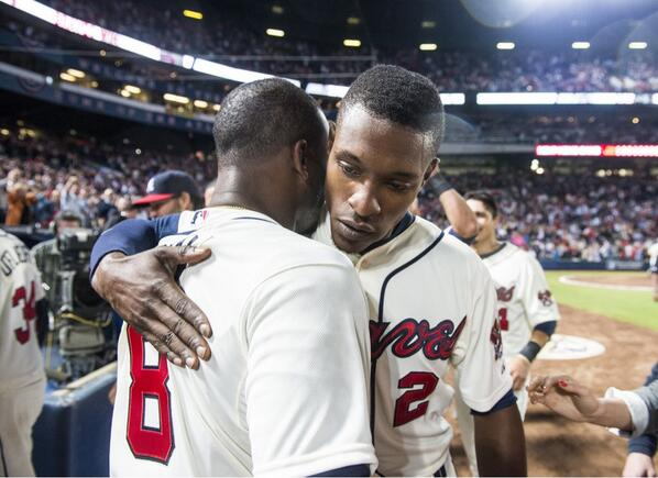 Photo of the Day (via @BravesPhoto):@JUP_8TL & @BJUPTON2 hug it out after they both homered in the 9th to beat Cubs. http://t.co/USHs2GeDdS