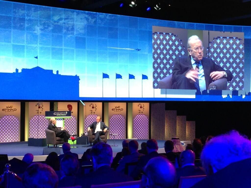 Legend Sir David Frost in red socks chats to Geoffrey Kent of @AKTravel_USA #WTTC @DOTW_News http://t.co/yl0eT5qL4u