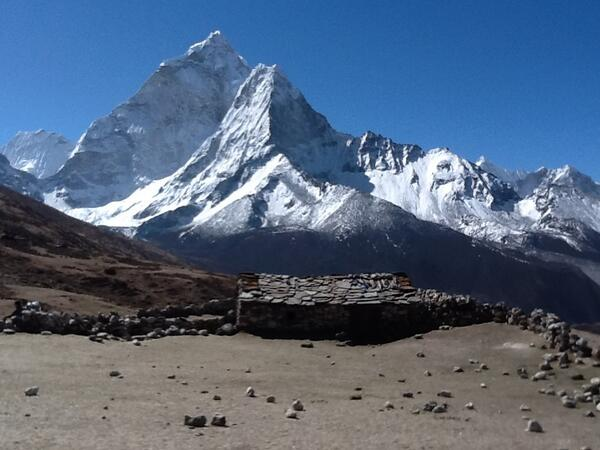 A yak-herder's hut with Ama Dablam towering in the background. Location, location, location! #SAConEverest http://t.co/lzwO4xw8Ga