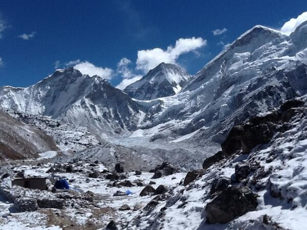 Base Camp is nearly at the centre of this picture, just left of the base of the snow triangle. #SAConEverest http://t.co/PMZJKFETSm