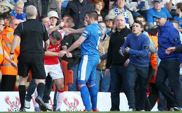 ...#Stockport fan punches Kiddy Harriers' Lee Vaughan... http://t.co/u1mmwC9T34