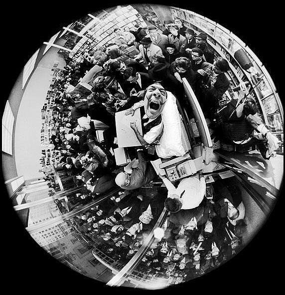 Salvador Dali at a book signing in 1963. Photographer Philippe Halsman took this with his fisheye lens. http://t.co/20aMrc7FH7
