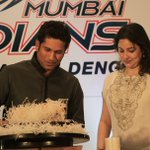 Pic: Sachin Tendulkar with his wife Anjali as he cuts his birthday cake.