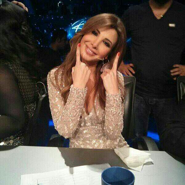 RT @KarimElSaeed: @NancyAjram check how amazing you look !! ♥ , flawless, elegant and beautiful , an angel on the earth . http://t.co/xQtijb1PuL