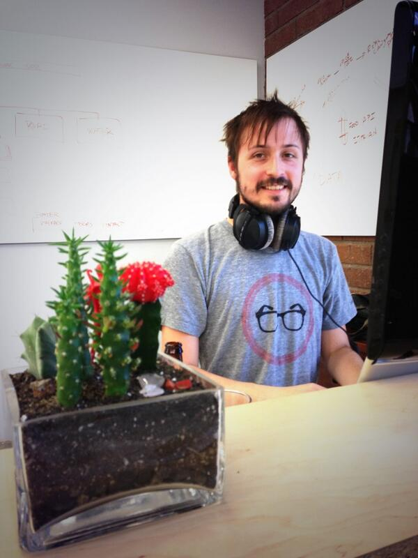 Its a party! Here's @_tlr_ rocking the @designersgeeks tee with a @JuicyKits planter at @hoverstate office. http://t.co/6xbhqgKCVm