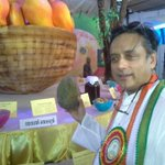 At Thiruvananthapuram's mango festival, holding a giant 1.4 kilo Kossery mango. 130 varieties on display,many on sale