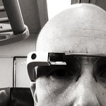 Sitting on a train, wearing Google Glass, afraid to say,
