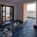 ":-) ""@ThatsEarth: Hot tub that goes inside to outside. With a view of the ocean."