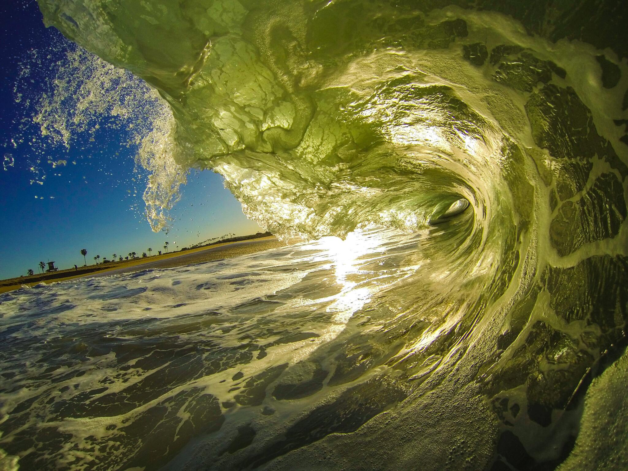 Photo of the Day! Sunrise at Newport Beach. Backlit wave shot by Kyle Redington. #GoPro #surf http://t.co/quQpltvTF2
