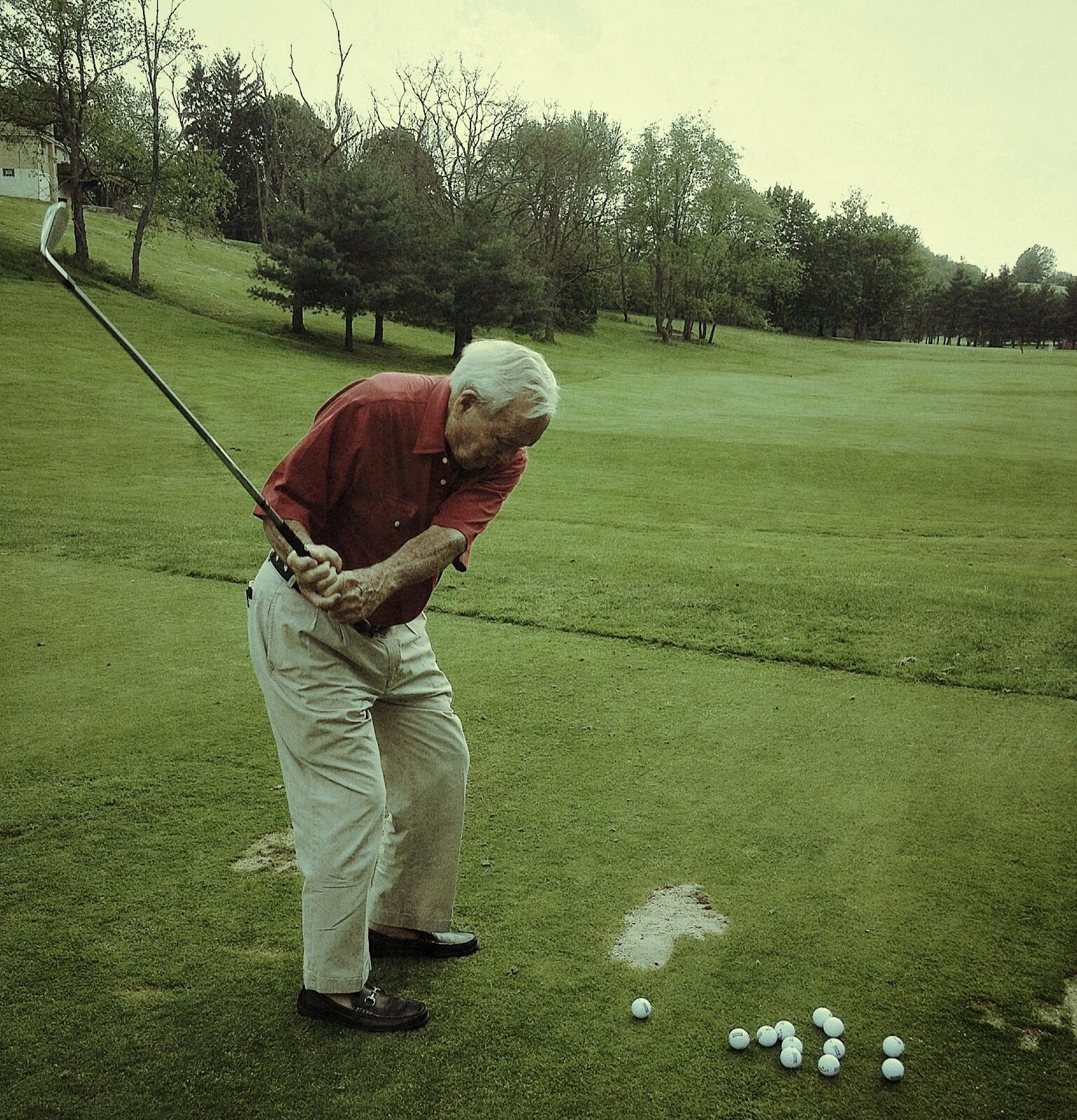 This photo of Arnold Palmer striping balls in loafers with his #XHOT irons today is the greatest thing ever. #TheKing http://t.co/DqRwROz83c