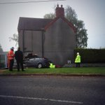 Photo of the RTC this morning involving a house near Washingborough. No injuries. @LincsFireRescue USAR stabilising http://t.co/5sq9Wo9sbG