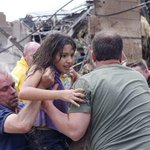 Wow. AP image of a child being pulled from the rubble of a school in Moore, OK. Credit: Sue Ogrocki. http://t.co/MlABKfKVKf