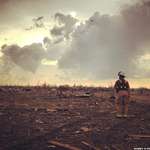 PICTURE: A firefighter surveys what remains of the elementary school in #Moore where the tornado killed 7 children